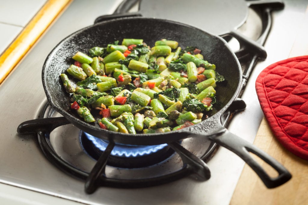 asparagus and kale on a skillet