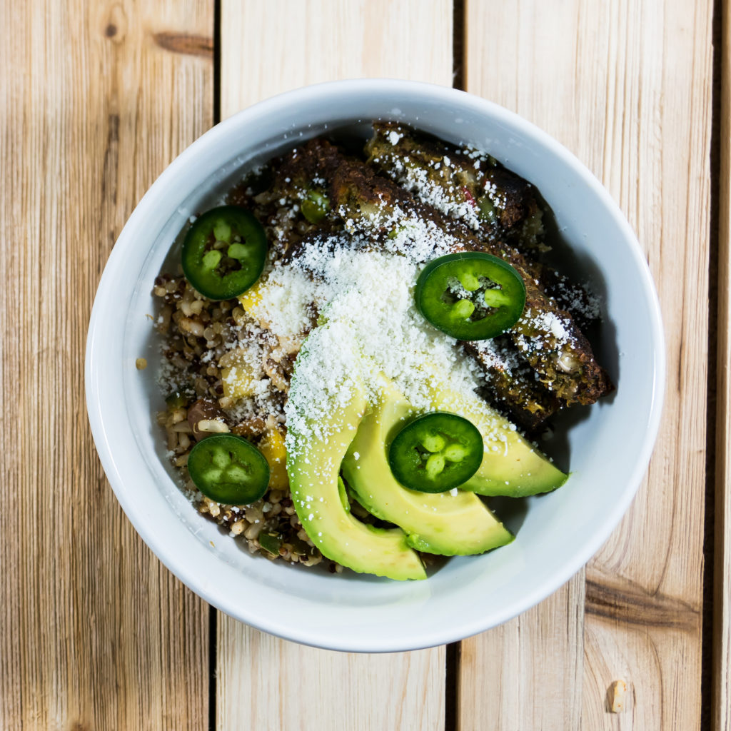 fiesta quinoa veggie burger and avocado bowl