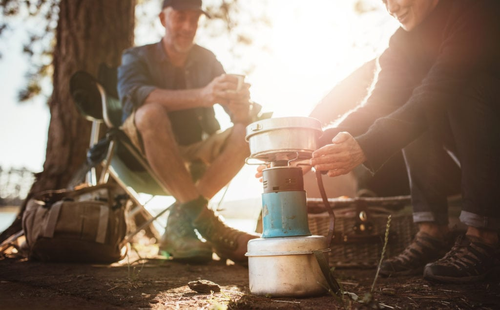 couple using camping stove