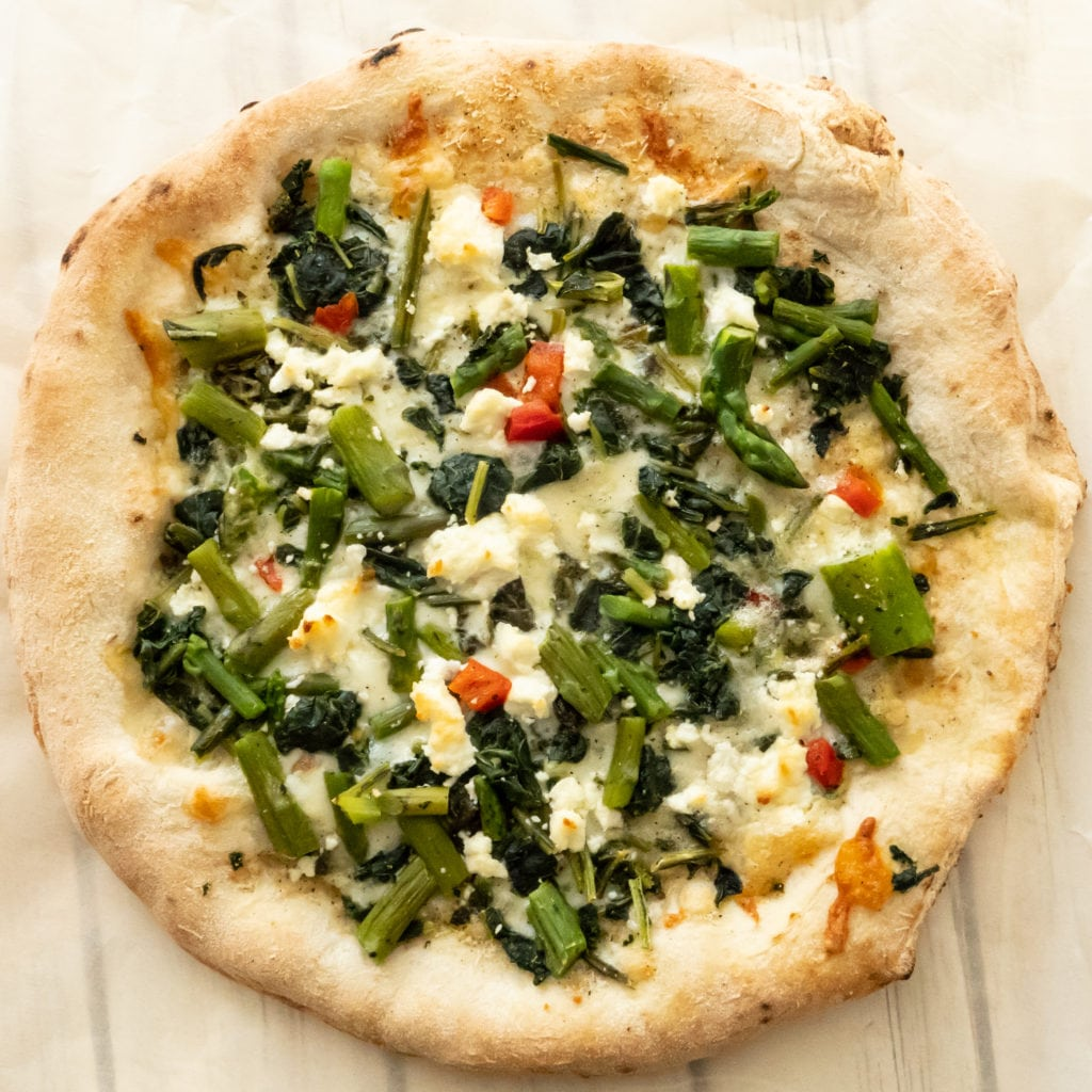 white pizza with Tommy's asparagus and kale and goat cheese