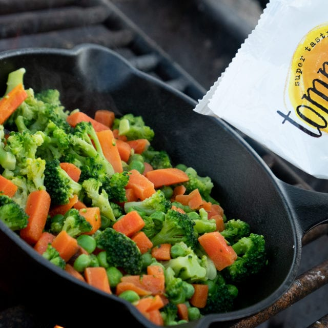 cooking frozen vegetables on a campfire